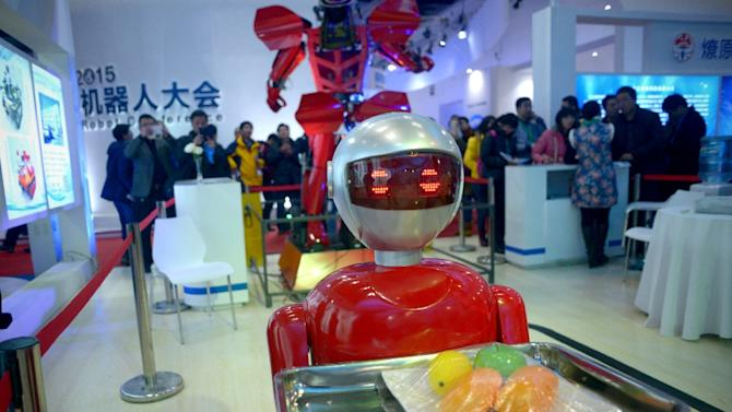 """Vehicles with automated gun turrets sat alongside drink-serving karaoke machines at the World Robot Conference, as manufacturers sought new buyers for their """"jiqiren"""" -- """"machine people"""" in Chinese"""