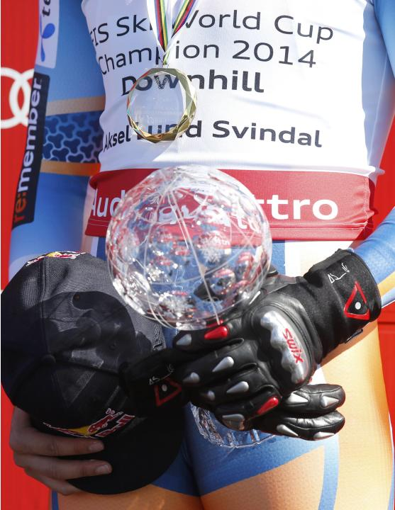 Svindal of Norway holds the trophy during official downhill overall winning ceremony at the FIS Alpine Skiing World Cup finals in the Swiss ski resort of Lenzerheide