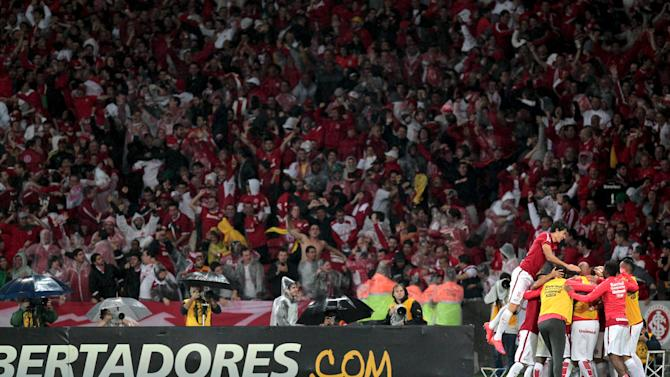 Players of Brazil's Internacional celebrate their second goal against Colombia's Santa Fe during their Copa Libertadores soccer match in Porto Alegre