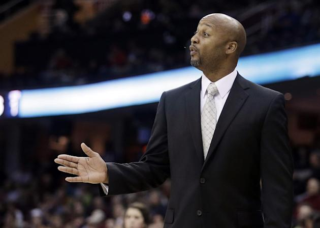 Denver Nuggets head coach Brian Shaw reacts during the first quarter of an NBA basketball game  against the Cleveland Cavaliers, Wednesday, Dec. 4, 2013, in Cleveland. The Cavaliers won 98-88