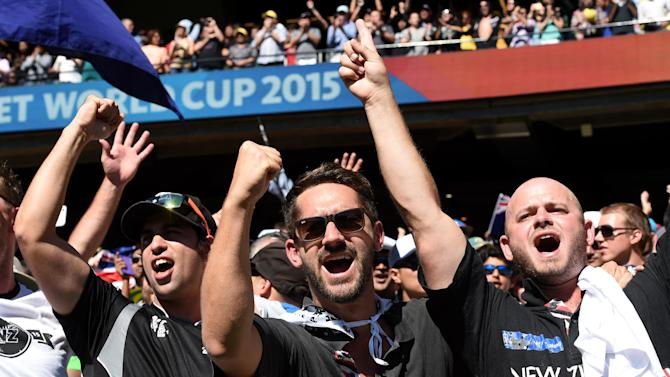 New Zealand fans cheer on their team during the Cricket World Cup final against Australia in Melbourne, Australia, Sunday, March 29, 2015. (AP Photo/Andy Brownbill)