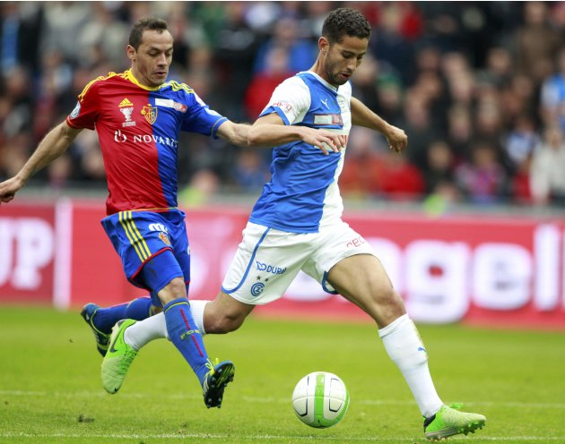 FC Basel's Diaz fouls Grasshopper's Ben Khalifa  in Swiss Cup final soccer match in Bern