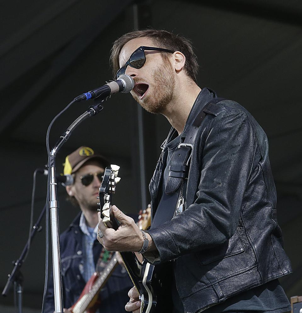 Dan Auerbach, foreground, performs with his band The Black Keys, the New Orleans Jazz and Heritage Festival in New Orleans, Sunday, May 5, 2013. (AP Photo/Gerald Herbert)
