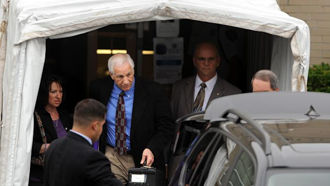 Jerry Sandusky leaves the Centre County Courthouse, in Bellefonte, Pa., Monday, June 18, 2012. The defense began presenting it's case in Sandusky's trial on 52 counts of child sexual abuse involving 10 boys over a period of 15 years on Monday.  (AP Photo/Centre Daily Times, Nabil K. Mark)