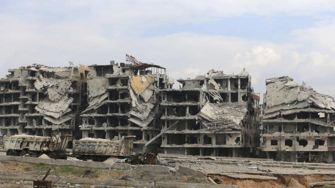 A general view shows damaged buildings and roads in Jobar