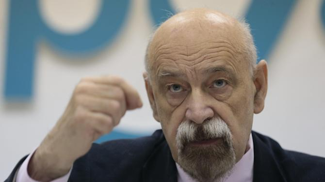 Russian prisoners rights activist Valery Borschev gestures during a news conference in Moscow, Russia, on Wednesday, Oct. 24, 2012. A respected Russian group of human rights activists has backed claims made by jailed opposition activist Leonid Razvozzhayev that he was tortured into confessing to plotting riots. (AP Photo/Ivan Sekretarev)