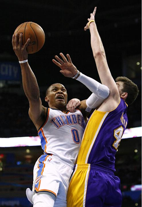 Oklahoma City Thunder guard Russell Westbrook (0) goes up for a shot as Los Angeles Lakers forward Ryan Kelly (4) defends during the third quarter of an NBA basketball game in Oklahoma City, Thursday,