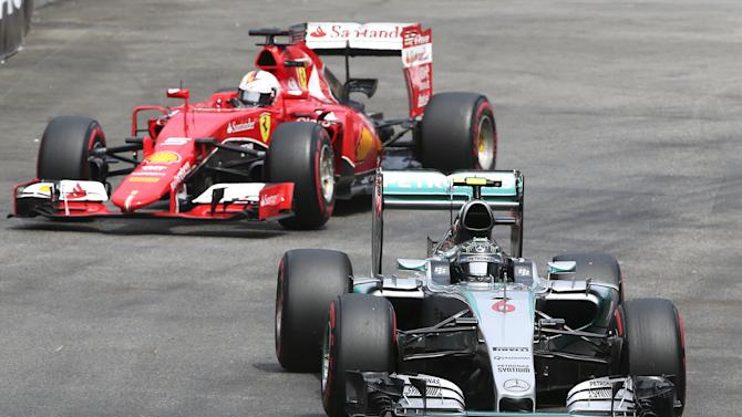 Mercedes Formula One driver Rosberg of Germany drives his car ahead of Ferrari Formula One driver Vettel of Germany during the third free practice session at the Monaco F1 Grand Prix