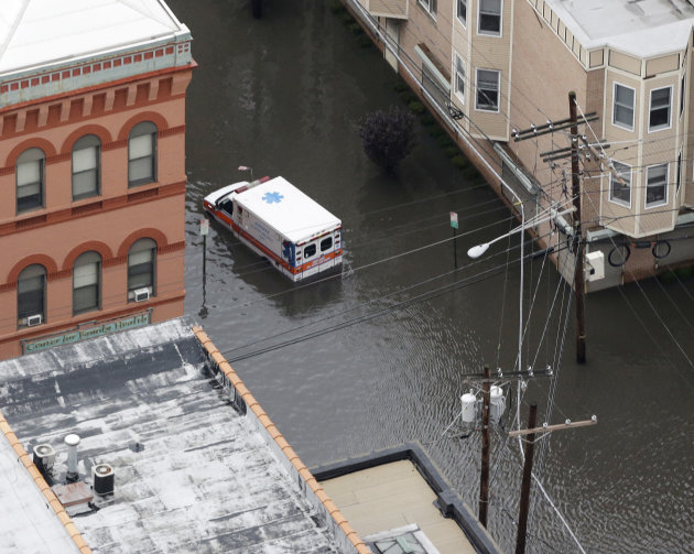An ambulance is submerged in floodwaters in the wake of superstorm Sandy on Tuesday, Oct. 30, 2012, in Hoboken, N.J. Sandy, the storm that made landfall Monday, caused multiple fatalities, halted mass