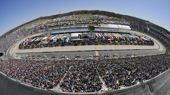 Joey Logano (22) leads the field at the start of the NASCAR Sprint Cup auto race at Martinsville Speedway in Martinsville, Va., Sunday, March 29, 2015. (AP Photo/Don Petersen)