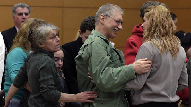 David Ranta is greeted by family members after Judge Miriam Cyrulnik freed him, in state Supreme Court in Brooklyn, New York,  Thursday, March 21, 2013. Ranta, 58, who spent more than two decades behind bars was freed on Thursday after a reinvestigation of his case cast serious doubt on evidence used to convict him in the Feb. 8, 1990 shooting of Rabbi Chaskel Werzberger. (AP Photo/Richard Drew, Pool)