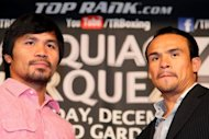 Manny Pacquiao (L) and Juan Manuel Marquez during a press conference in California on September 17. Pacquiao says he is making major changes to his preparations this time for the December 8 non-title fight at the MGM Grand Hotel in Las Vegas