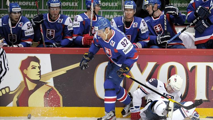 Slovakia's Branko Radivojevic tackles USA's Joey Crabb, right, during their Group H game USA vs Slovakia of the 2012 IIHF Ice Hockey World Championships in Helsinki, Finland on Monday, May 7, 2012. (AP Photo/Lehtikuva, Antti Aimo-Koivisto)  FINLAND OUT