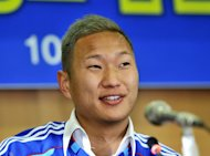 North Korean striker Jong Tae-Se speaks as he wears his Suwon Samsung Bluewing uniform during a press conference for his transfer in Seoul on January 10, 2013. Jong finalised his move to South Korea&#39;s K-league, vowing to score at least 15 goals for his new team the Suwon Samsung Bluewings before the end of the season