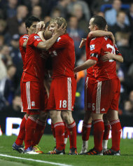 Liverpool&#39;s Glen Johnson, left, is hugged by Dirk Kuyt, centre, after scoring during the English Premier League soccer match between Chelsea and Liverpool at Stamford Bridge Stadium in London, Sunday, Nov. 20, 2011. (AP Photo/Kirsty Wigglesworth)