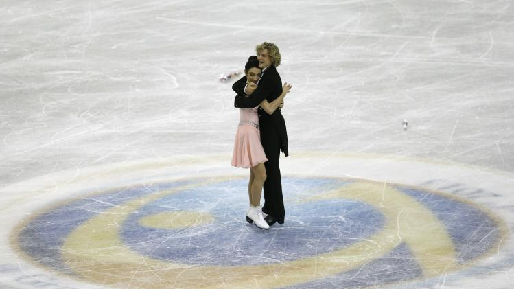 Davis and White of the U.S. react after performing during the ice dance short dance at the ISU Grand Prix of Figure Skating Final in Fukuoka
