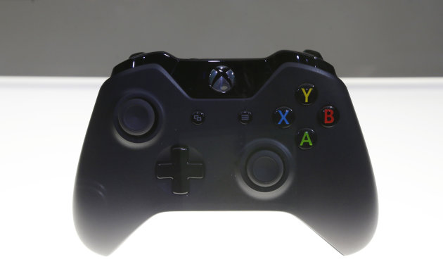 A controller for Microsoft Corp.'s Xbox One entertainment and gaming console system is on display after its unveiling Tuesday, May 21, 2013, at an event in Redmond, Wash. The Xbox One, a next-generati