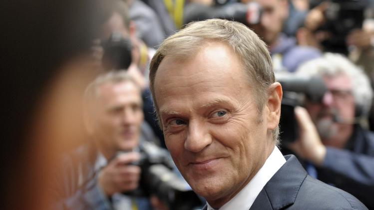 Poland's Prime Minister Donald Tusk arrives at the European Council headquarters ahead of a EU summit in Brussels