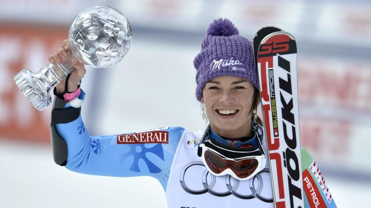 Tina Maze of Slovenia lifts the crystal globe as the winner of the overall Giant Slalom ladies World Cup at the FIS Alpine Ski World Cup finals, in Parpan - Lenzerheide, Switzerland, Sunday, March 17, 2013. (AP Photo/Keystone/Peter Schneider)