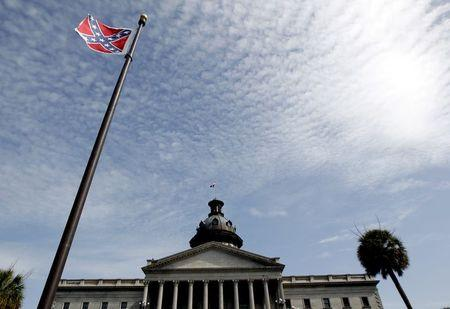 A Confederate flag stands in front of the South Carolina State House in Columbia
