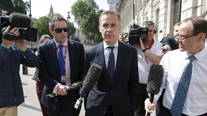 Governor of the Bank of England, Carney, leaves the Cabinet Office, following a post-Greek referendum meeting in London