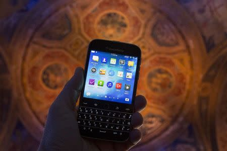 BlackBerry third-quarter revenue falls more than expected, shares slide