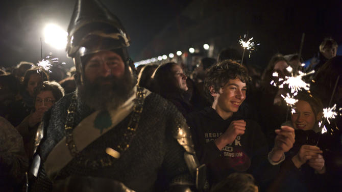 A man dressed like a Middle Age soldier, left, attends ceremonies marking the 600th anniversary of the birth of Joan of Arc, in Orleans, central France, Sunday April 29, 2012. The city of Orleans goes all out with celebrations marking the 600th birthday of Joan of Arc, a national icon and symbol of French resistance through the ages at a time when French identity and France's role in the world are a focus in the presidential campaign.  (AP Photo/Thibault Camus)