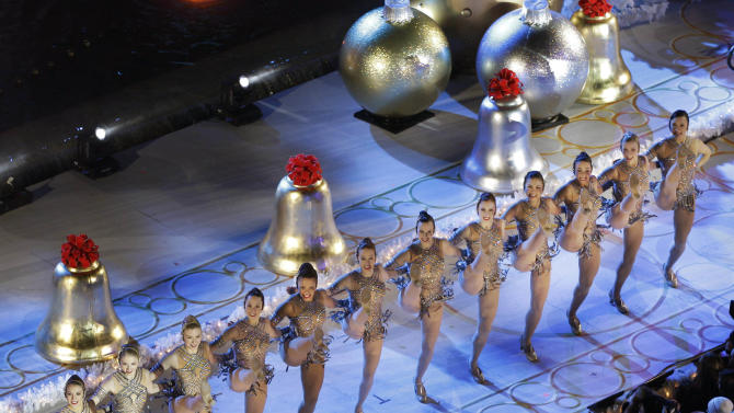 The Radio City Music Hall Rockettes perform before the Rockefeller Center Christmas Tree is lit during the 80th annual tree lighting ceremony at Rockefeller Center in New York, Wednesday, Nov. 28, 2012.  (AP Photo/Kathy Willens)