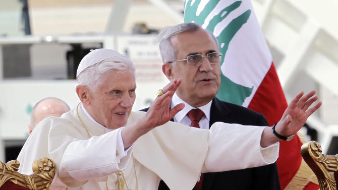 "Pope Benedict XVI stands next to Lebanese President Michel Suleiman as he waves to the crowd at Rafik Hariri international airport, in Beirut, Lebanon, Friday, Sept. 14, 2012. Pope Benedict XVI arrived in Lebanon on Friday to urge peace at a time of great turmoil in the Middle East, saying the import of weapons to Syria during the country's civil war is a ""grave sin."" The three-day visit comes at a time of turmoil in the region — the civil war in neighboring Syria and in the aftermath of a mob attack that killed several Americans in Libya, including the U.S. ambassador. (AP Photo/Bilal Hussein)"