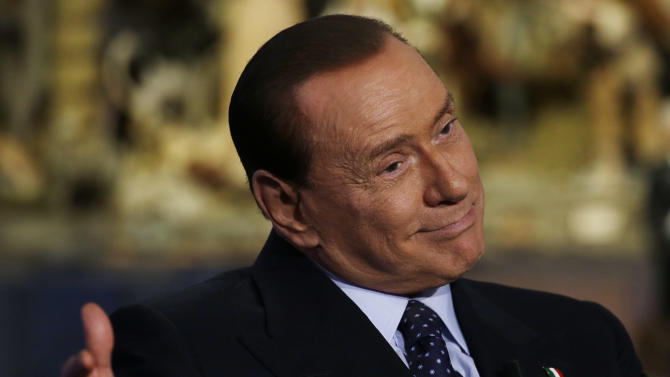 """Former Italian Premier and People of Freedom party Leader Silvio Berlusconi attends the recording of RAI (Italian State Television) TV talk show """"Porta a Porta""""(Door to Door) hosted by journalist Bruno Vespa, in Rome, Tuesday, Dec. 18, 2012. Three times premier, Berlusconi insists Italy needs him and says voters soon will indicate if they are tired of him. The media mogul has flip-flopped in recent days on whether he'll run for the premiership in elections expected for February. Berlusconi resigned as premier in 2011 as Italy's debt crisis worsened, making way for economist Mario Monti to take the helm. (AP Photo/Gregorio Borgia)"""