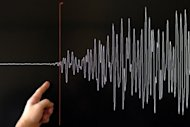 A scientist points to a seismograph of a major earthquake. A 6.0-magnitude earthquake has struck off Mexico's Pacific coast close to the Guatemalan border, but there were no immediate reports of damage or casualties