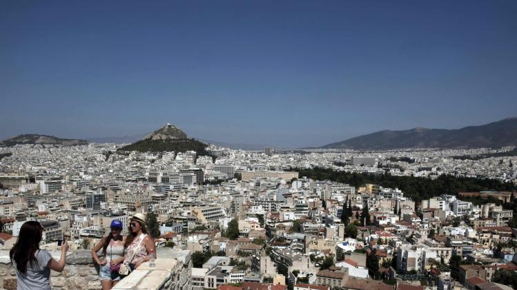 File photo shows tourists posing for a photo at the top of the Acropolis hill in Athens