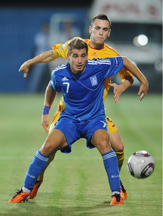 Lucian Murgoci  (R) of Romania vies with Charis Mavrias (L) of Greece during the final football match of the UEFA European Under-19 Championship 2010/2011 in Berceni village next to Bucharest July 23,