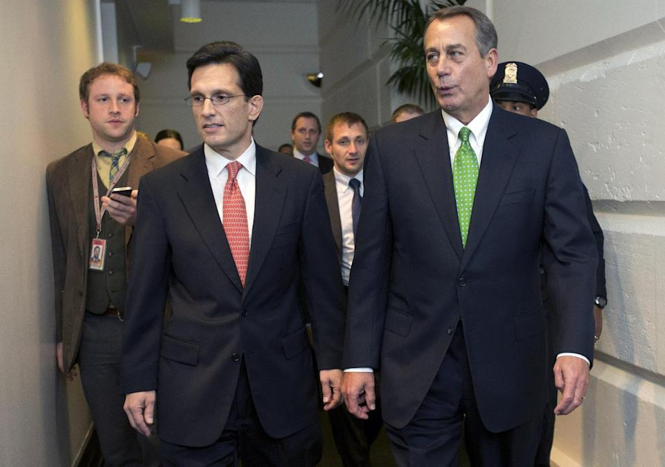 House Majority Leader Eric Cantor, R-Va., left, and Speaker of the House John Boehner, R-Ohio, arrive to a second Republican caucus meeting at the U.S. Capitol in Washington, on Tuesday, Jan. 1, 2013. (AP Photo/Jacquelyn Martin)