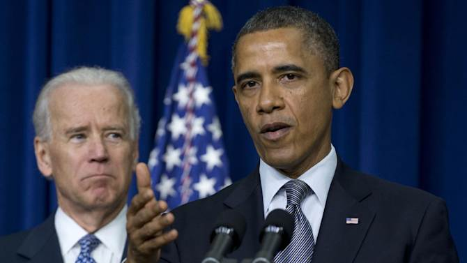 President Barack Obama, accompanied by Vice President Joe Biden, gestures as he talks about proposals to reduce gun violence, Wednesday, Jan. 16, 2013, in the South Court Auditorium at the White House in Washington.  (AP Photo/Carolyn Kaster)