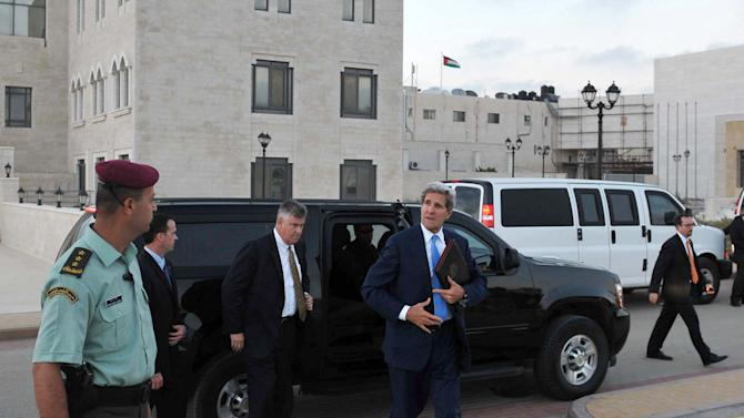U.S. Secretary of State John Kerry steps out of a vehicle as he prepares to depart from a meeting with Palestinian President Mahmoud Abbas on Friday, July 19, 2013 in the West Bank city of Ramallah. U.S. Secretary of State John Kerry stepped up his drive to get Israelis and Palestinians back to the negotiating table, meeting with the Palestinian president Friday as he sought to close a deep divide between the two sides over a formula for resuming peace talks after nearly five years.(AP Photo/Mandel Ngan, Pool)