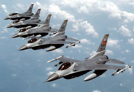 "File handout photo of five U.S. Air Force F-16 ""Fighting Falcon"" jets flying in echelon formation over the U.S. en route to an exercise"
