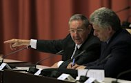 SETTING THE SCENE FOR CHANGE: Cuban President Raul Castro, left, addresses the audience next to newly elected First Vice-President Miguel Diaz-Canel during the closing session of the Cuban National Assembly in Havana on Sunday. Picture: REUTERS