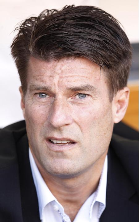 Swansea City's manager Michael Laudrup from Denmark waits for the start of their Europa League Group A soccer match against Valencia at the Mestalla stadium in Valencia, Spain, Thursday, Sept. 19, 201