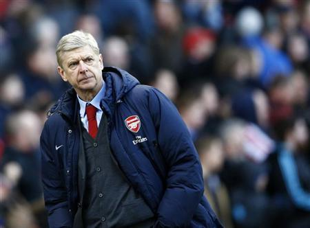 Arsenal manager Wenger walks off the pitch following their English Premier League soccer match defeat to Stoke City at the Britannia stadium in Stoke-on-Trent