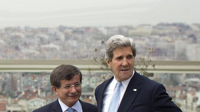 Turkish Foreign Minister Ahmet Davutoglu, left, shows U.S. Secretary of State John Kerry, the skyline of Istanbul before the start of a meeting on Sunday, April 21, 2013, in Istanbul, Turkey. Kerry is wrapping up a 24-hour visit to Istanbul with talks aimed at improving ties between Turkey and Israel and pushing ahead with Mideast peace efforts. (AP Photo/Evan Vucci, Pool)