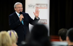 Australian PM Kevin Rudd speaks during a debate with…