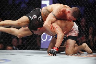 Diego Sanchez (top) has the advantage over Gilbert Melendez in UFC 166. (USA TODAY Sports)