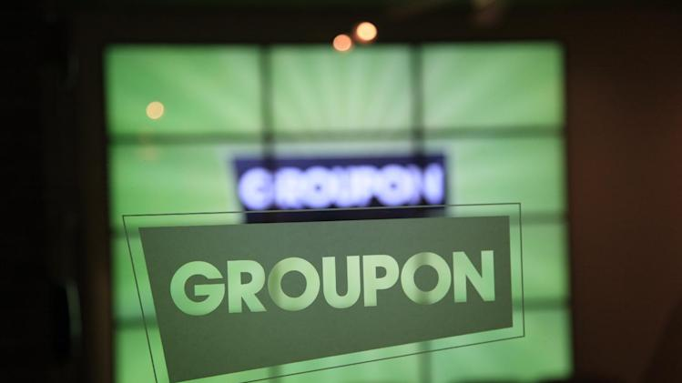 In this Thursday, Sept. 22, 2011, file photo, the Groupon logo is etched in glass in the lobby of the online coupon company's Chicago offices. Groupon's stock is tumbling as insiders are selling their shares after a post-IPO prohibition was lifted.  (AP Photo/Charles Rex Arbogast)