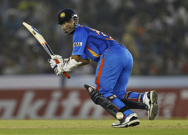 India's batsman Ajinkya Rahane bats during their third one-day international cricket match against England in Mohali, India, Thursday, Oct. 20, 2011. (AP Photo/Aijaz Rahi)