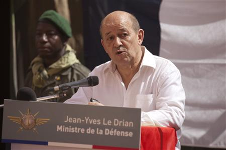 France's Defence Minister Jean-Yves Le Drian speaks to French soldiers at a French military encampment at a Malian air base in Gao March 7, 2013. REUTERS/Joe Penney