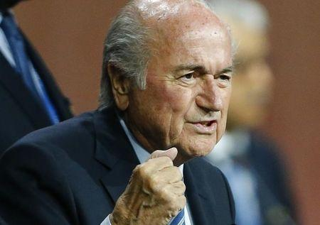 FIFA President Blatter reacts after he was re-elected at the 65th FIFA Congress in Zurich