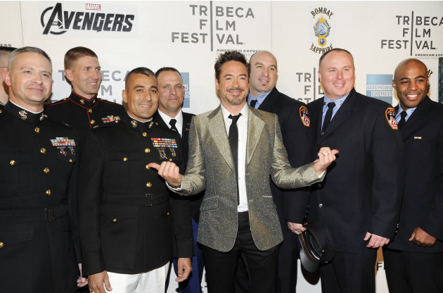 "Actor Robert Downey Jr., center, poses with members of the U.S. Military and New York Fire Department before the premiere of ""The Avengers"" during the 2012 Tribeca Film Festival on Saturday, April 28,"