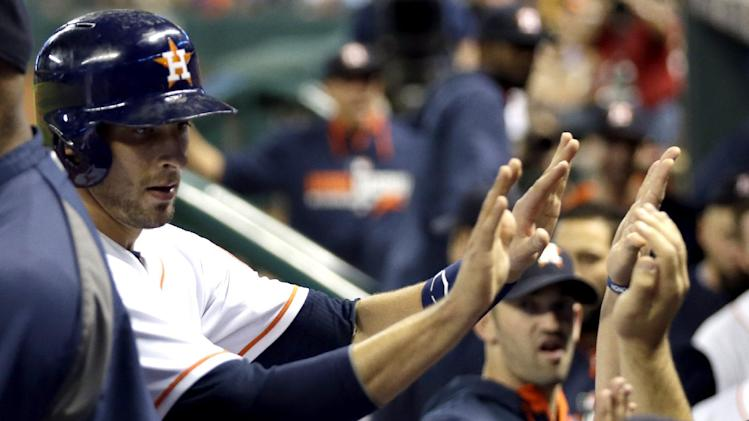 Houston Astros' Jason Castro, left, is congratulated after scoring against the Toronto Blue Jays during the third inning of a baseball game Thursday, July 31, 2014, in Houston. (AP Photo/David J. Phillip)