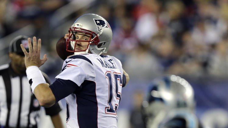 New England Patriots quarterback Ryan Mallett looks for a receiver against the Carolina Panthers in the first half of an NFL preseason football game Friday, Aug. 22, 2014, in Foxborough, Mass. (AP Photo/Charles Krupa)